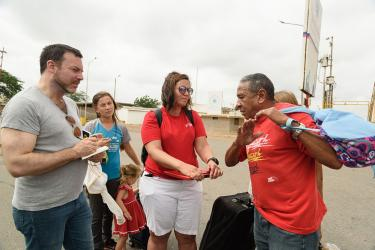 Mercy corps employees speaking with venezuelan family
