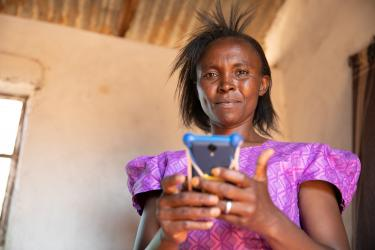 Lydia with cell phone in Kenya