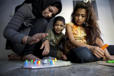 A young boy and girl playing a board game