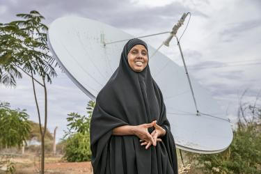 Woman standing in front of a large satellite