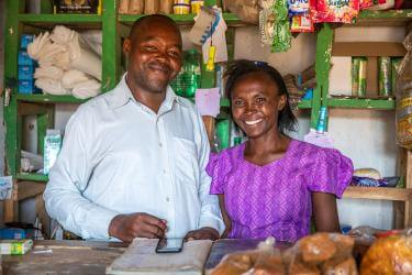 Lydia and her husband at their small shop. Lydia relies on rain-fed agriculture to support her family, a livelihood that has become increasingly fragile with the growing effects of climate change. Photo: Ezra Millstein for Mercy Corps