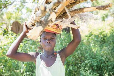 Young woman with a harvest of lumber