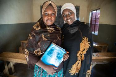 Two women stand in a classroom in nigeria