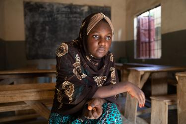 A woman sitting in a classroom in nigeria