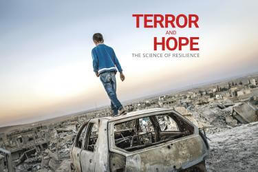 A young person walks on the roof of a destroyed vehicle among the rubble of a destroyed city with the documentary title floating overhead reading terro and hope, the science of resilience.