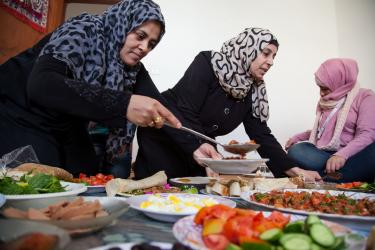 People serving food in jordan.