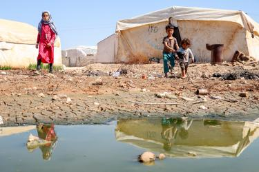 Syrians living in a camp for displaced persons after fleeing conflict in Idlib