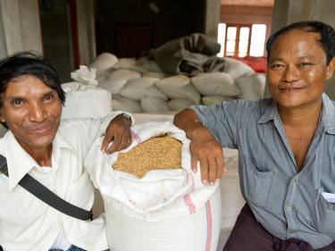 Kyi, pictured left, with a bag of rice