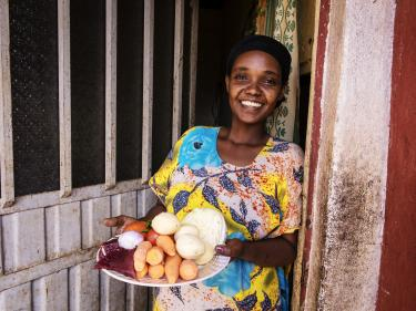 All over the world, people like meseret in ethiopia want to feed their families healthy and nutritious meals. how do we help them thrive? photo: sean sheridan for mercy corps