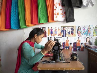 Girl using sewing machine