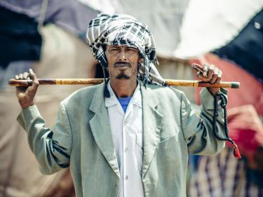 A portrait of a pastoral beneficiary holding a stick in kebribeyah, ethiopia.