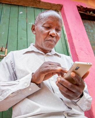 Kenyan man on his smartphone